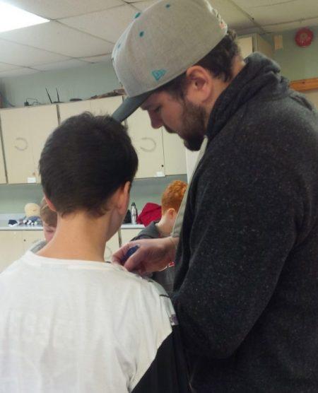 Stone Art Workshops child and instructor