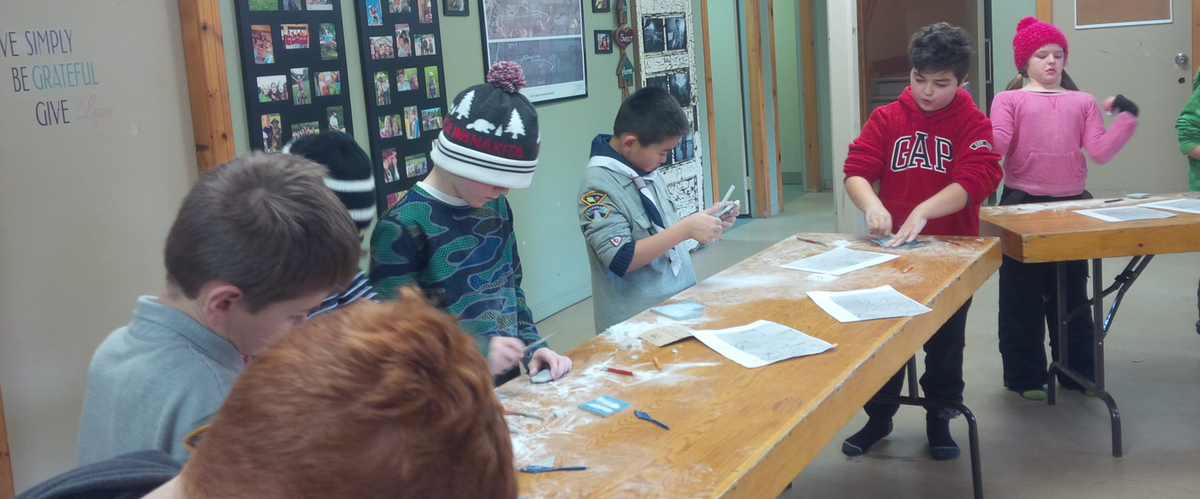 Kids participating in Stone Art Workshops